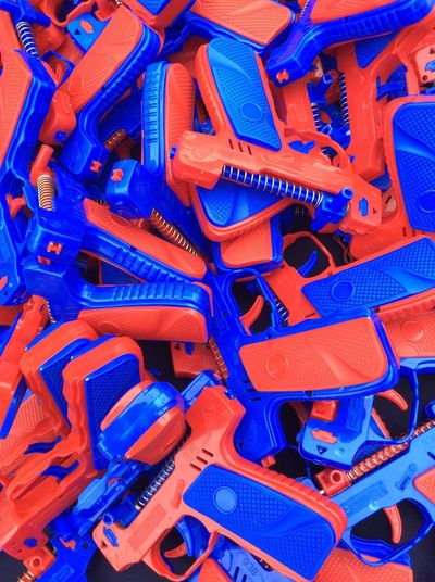 Plastic toy guns red and blue Street Market In Malaysia Primary Colours No People Full Frame Close-up Day Sunlight EyeEm Best Shots I Pad Mini Jan 2017 I Pad Photography Large Group Of Objects For Sale To Children Children's Toys