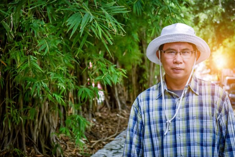 Portrait of mature man wearing hat