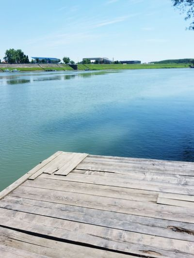 Water Pier Lake Jetty Wood - Material Outdoors Tranquil Scene Tranquility Nature Summer No People Day Sky Scenics Beauty In Nature Landscape Tree