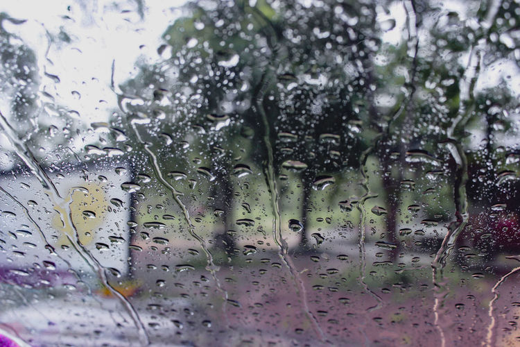 Close-up of wet glass window in rainy season