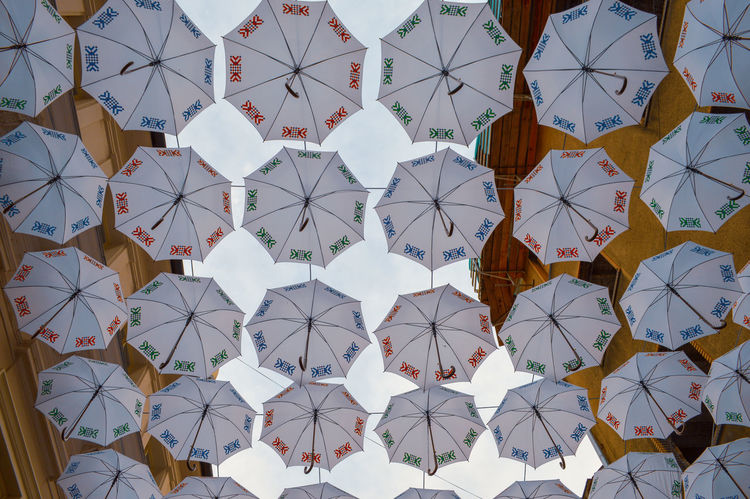 Under the umbrellas Umbrellas Street Streetphotography Street Scene Urbanphotography City Street Urban Scene Backgrounds Full Frame Multi Colored Pattern Close-up Architecture Repetition LINE Abstract Backgrounds Architectural Detail Architecture And Art Abstract Geometric Shape Architectural Design Architectural Feature 10 The Street Photographer - 2018 EyeEm Awards