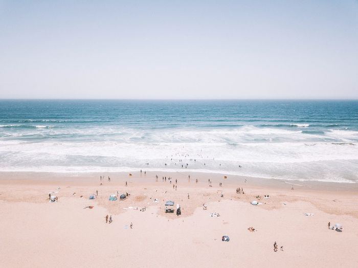 Beach Land Sea Water Sand Beauty In Nature Scenics - Nature Nature Wave Motion Day Tranquility Horizon Over Water Idyllic Aquatic Sport Sport Sky Tranquil Scene Outdoors