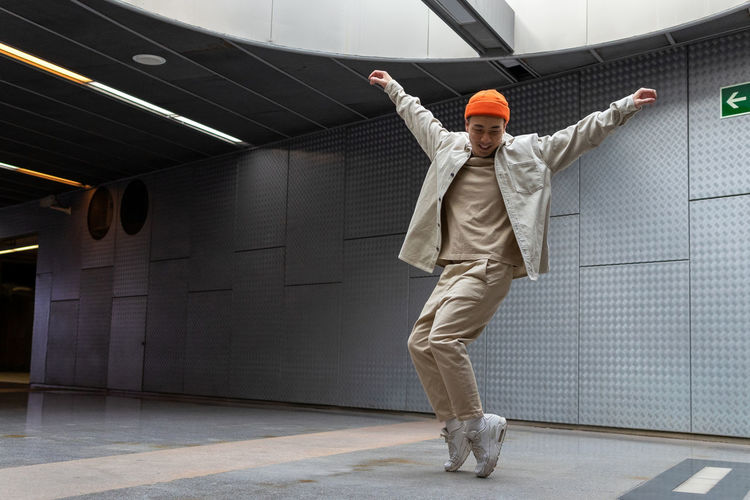 Full length of man standing on wall