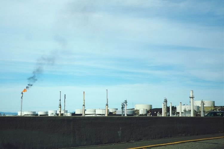 Taking Photos Snapshot Oil Refinery Chimney Flame Flames & Fire Smokeinthesky Brightsky Blue Sky Air Pollution Burning Fossil Energy Blacksmoke Petroleum Ontheroad View From The Car On The Freeway Drivebyphotography Drivebyshooting Landscape Ironic  Ironic View From My Point Of View