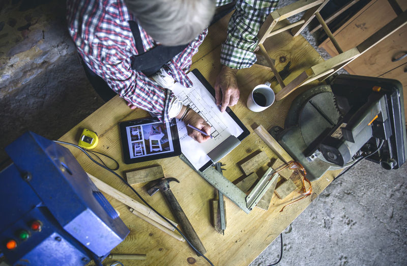 High angle view of man and woman working on table