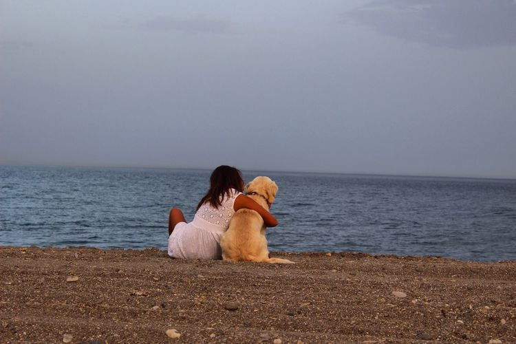 EyeEm Selects Dog Pets Sea Togetherness Friendship Horizon Over Water Sitting Beach Animal Themes Relaxation Bonding Real People Leisure Activity Water Two People Day Lifestyles Young Adult Young Women Pet Portraits Summer Exploratorium