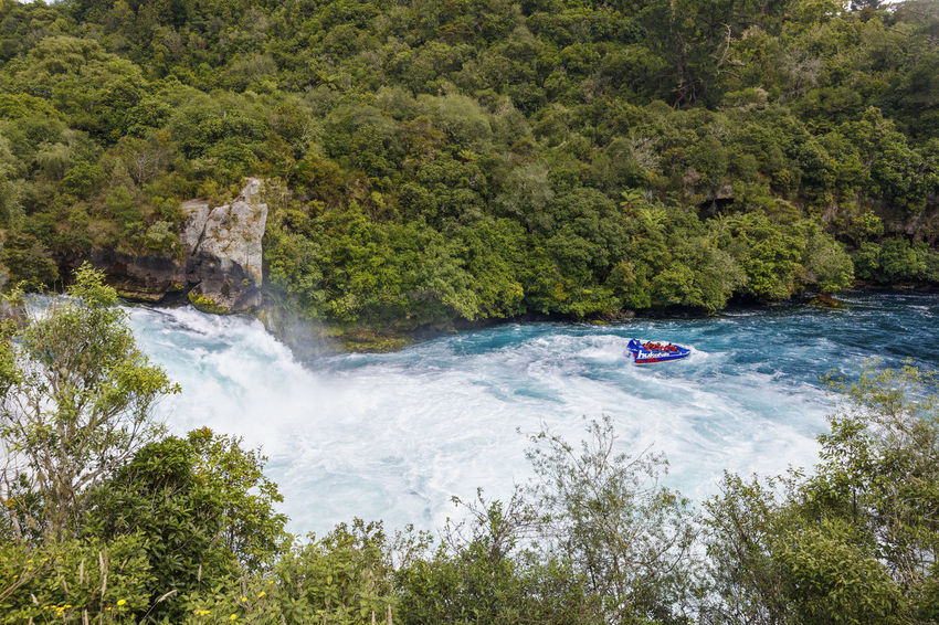 Panoramic view of Huka Falls, New Zealand NZ New Zealand Scenery Adventure Beauty In Nature Day Flowing Water Forest Huka Falls Land Mode Of Transportation Motion Nature Nautical Vessel New Zealand Newzealand Outdoors Plant River Scenics - Nature Speed Transportation Travel Tree Water Waterfall