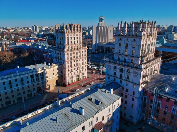 High angle view of buildings against blue sky