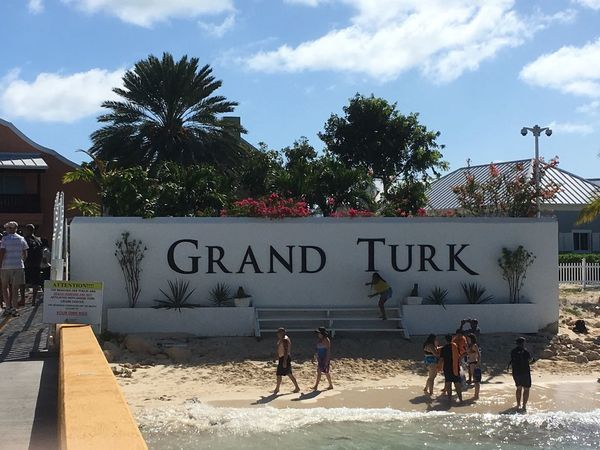 Grand Turk was good! Text Vacations Travel Destinations Lifestyles Sky Tree Leisure Activity Palm Tree Real People Outdoors Women Day Beach Men Water Architecture People Adult
