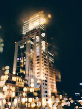 The Week On EyeEm Double Exposure Architecture Illuminated Night Building Exterior Built Structure City Low Angle View Skyscraper Cityscape Defocused No People Outdoors