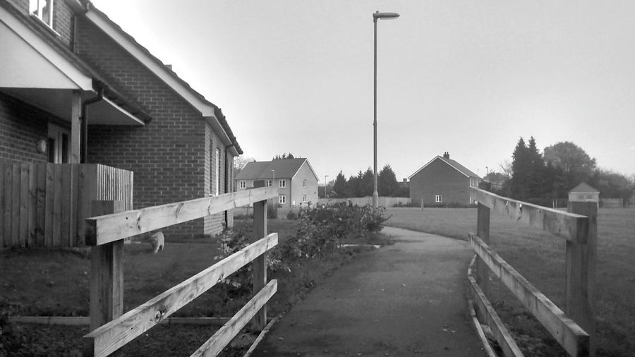 Houses Pathway Fence Neighborhood Black & White Tranquil Scene Grass day Sky No People Light Post