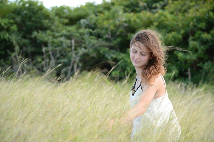 Adult Beauty Day Desaturated Grass Green Color Happiness Human Body Part Long Hair Lush - Description Nature One Person Outdoors People Portrait Smiling Timothy Grass Young Adult