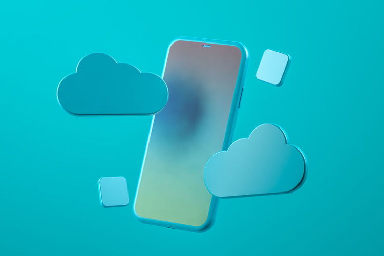 High angle view of smart phone against blue background