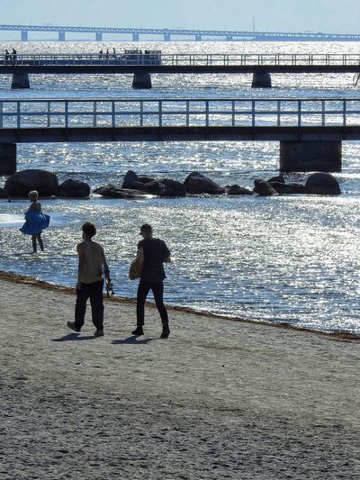 People on beach by sea
