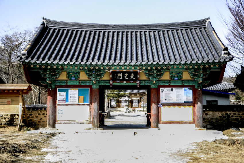 Ancient Civilization Architecture Buddhist Temple Building Exterior Built Structure Communication Culture Cultures Day Gate History House In A Row Non-western Script Old Red Religion Religions Residential Structure Roof Rural Scene Silsangsa Text Wall Western Script