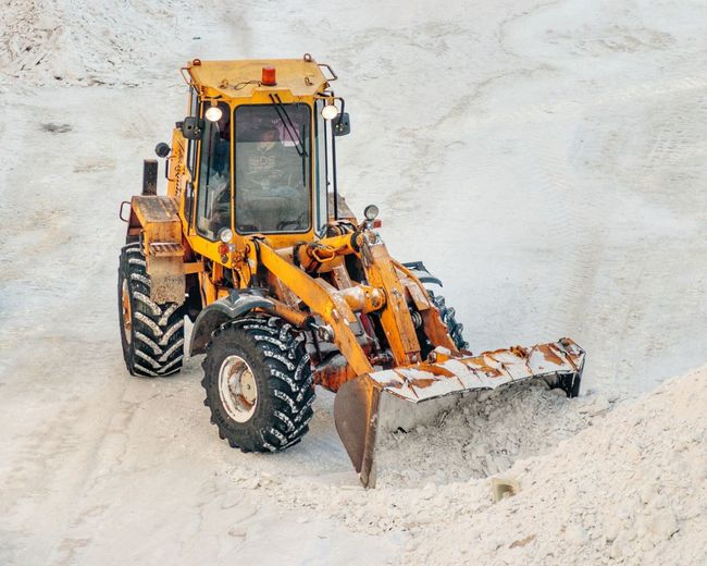 Bulldozer on snow covered field