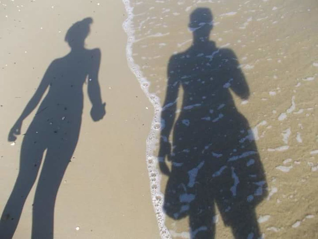 shadow, beach, focus on shadow, real people, men, sand, silhouette, lifestyles, leisure activity, outdoors, sunlight, day, standing, two people, women, water, nature, people