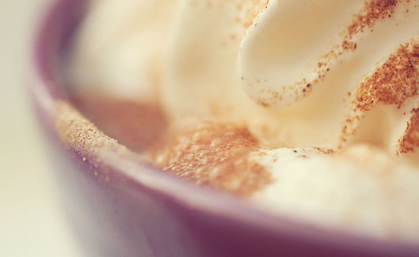 Close-up of whipped cream on hot chocolate