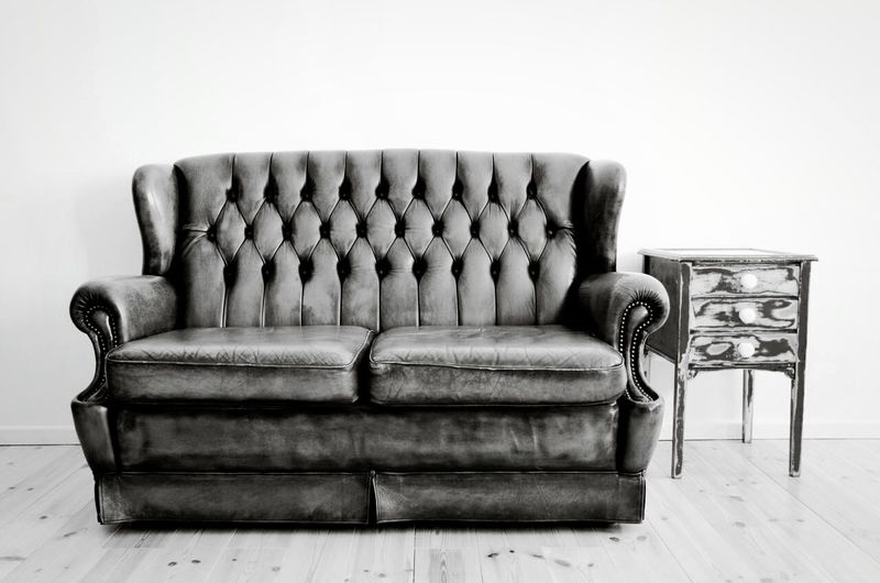 Couch Against White Wall