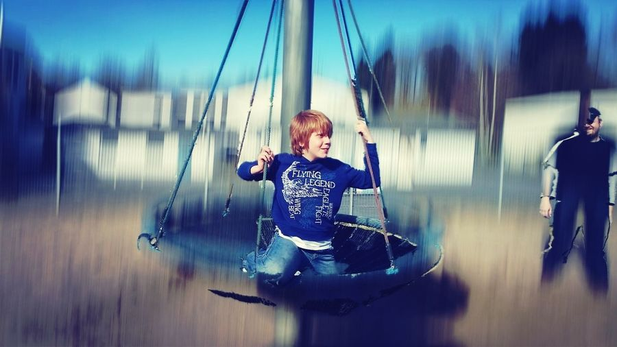 Boy Enjoying Ride In Park
