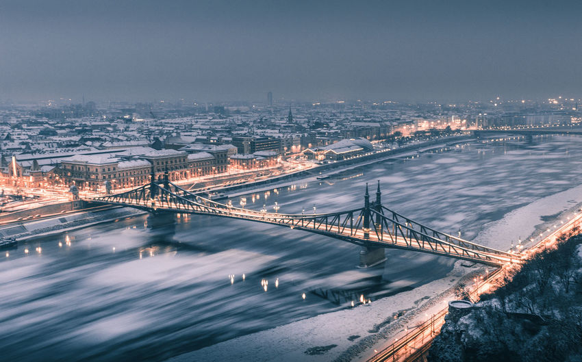 Architecture Bridge - Man Made Structure Building Exterior Built Structure Chain Bridge City Cityscape Connection Danube Engineering Ice Illuminated Liberty Bridge Long Exposure Motion Night No People Outdoors River Sky Suspension Bridge Transportation Travel Destinations Water Winter