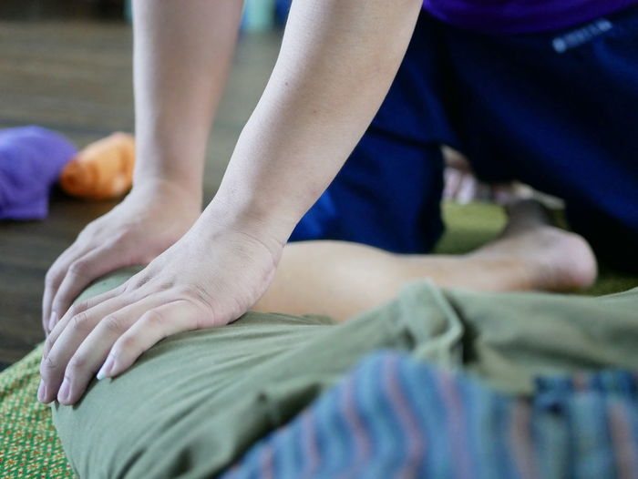 Hands of professional Thai masseur (male massager) pressing his fingers on a left leg of a customer - customer's point of view EyeEmNewHere Thai Thailand Client Close Up Customer  Fingers Hands Health Care Leg Lifestyles Man Massage Massager Massaging Masseur Press Professional Relaxed Selective Focus Service Skilled Therapy Traditional Treatment