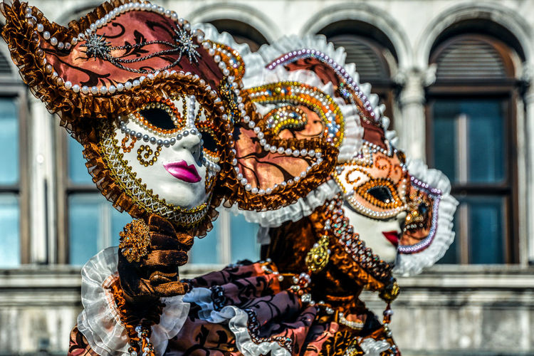 Close-up of woman wearing venetian mask and costume