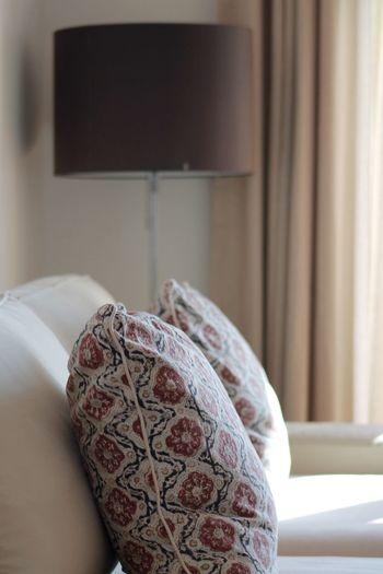 Close-up of cushions on sofa at home