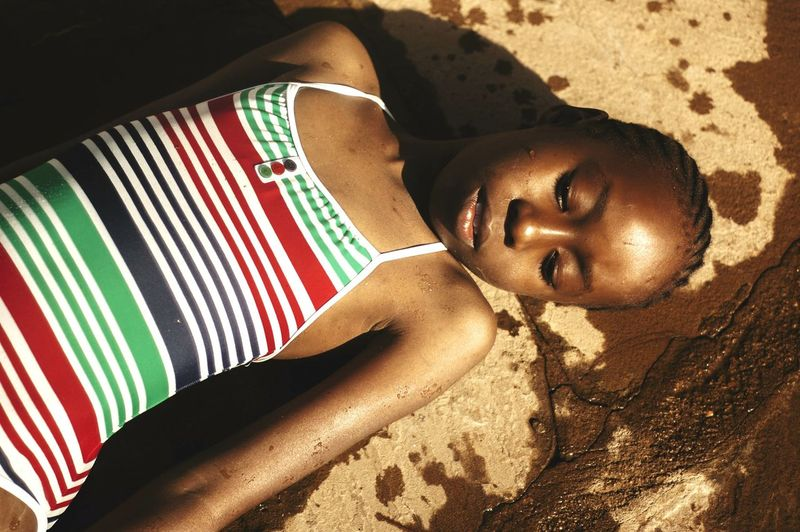 High angle view of girl lying outdoors