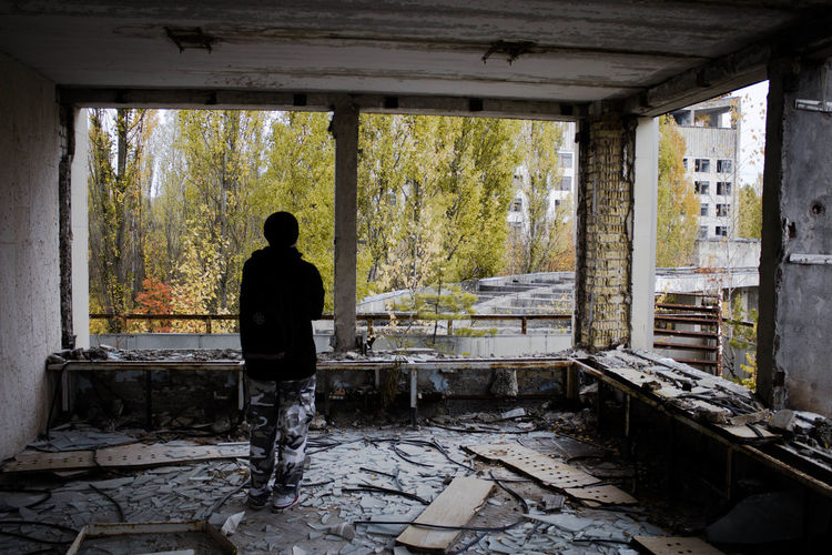 Rear View Of Person Standing In Abandoned Room