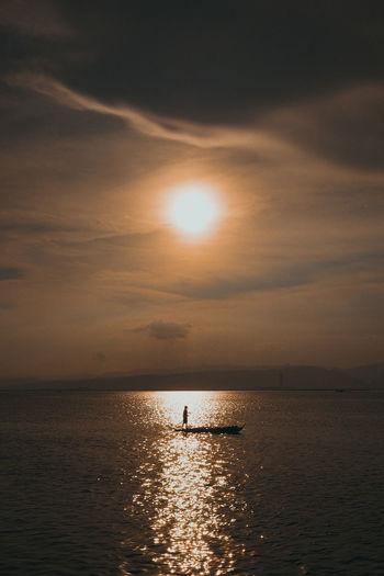 Under the spotlight Golden Hour Philippines Cebu Philippines Sailing Calm Cebu Sea Sunset Paddleboarding Full Length Oar Silhouette Togetherness Sun Water Sky Rowboat The Great Outdoors - 2019 EyeEm Awards The Street Photographer - 2019 EyeEm Awards