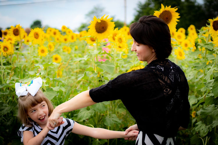 Flower Child Childhood Togetherness Females Young Women Girls Rural Scene Smiling Happiness Sunflower Growing In Bloom Flower Head Blooming Plant Life Farmland