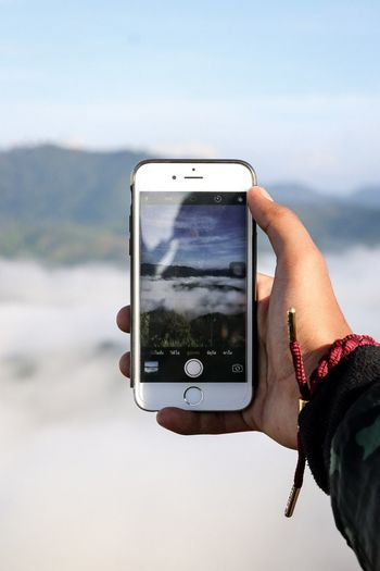Via Iphone Hiking Sunrise Suset Morning Wood Nature IPhone Rastaclat Fog Human Hand Hand Technology Smart Phone Wireless Technology Communication Portable Information Device One Person Mobile Phone Photography Themes Holding Activity Screen Photographing Outdoors