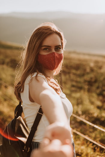 Woman with mask going to adventure travel with her boyfriend