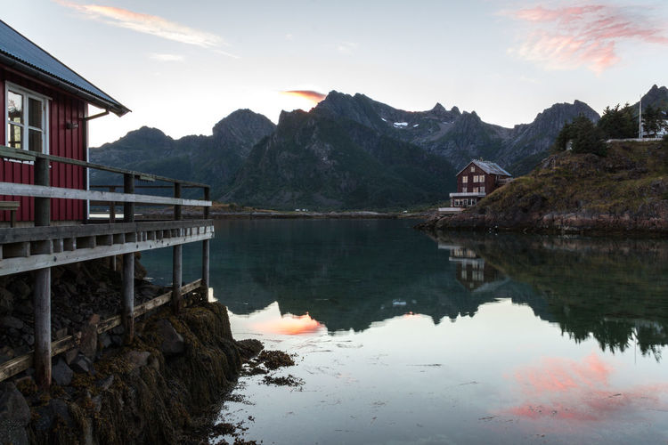 Amazing landscape from Lofoten - Norway Norway Reflection Architecture Beauty In Nature Building Exterior Built Structure Day Fisher House Lake Lofoten Mountain Mountain Range Nature No People Outdoors Reflection Scenics Sky Summer Sunrise Sunset Svolvær Tree Vacation Water