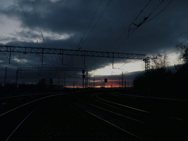 Set Off Dark City Nightfall Sunset Rail Road Rail Lines Road Railway Rail Railroad Track No People Public Transportation Rail Transportation Night Sky Outdoors EyeEmNewHere Day Railway Track Power Line  Cloud - Sky Connection Transportation Cable Power Supply Electricity  Electricity Pylon Silhouette Mobility In Mega Cities