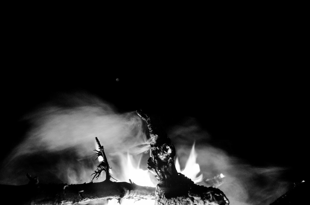 burning, flame, heat - temperature, smoke - physical structure, night, motion, close-up, no people, bonfire, outdoors, animal themes, nature
