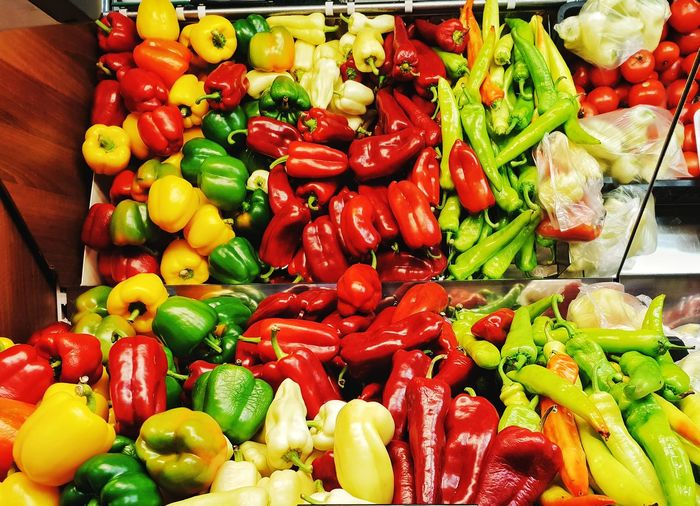 High angle view of bell peppers and vegetables