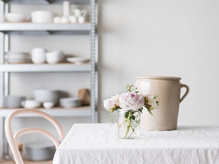 EyeEm Selects Table Table Setting Tablescene Interior Interior Design Shelf Shelf Display Flowers Peonies Indoors  Dining Table Dining Room Minimal Nordic Scandinavian Light Bright Linen Focus On Foreground Close-up Freshness White Color No People Tablecloth