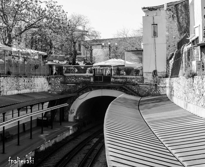 A train station at the heart of the city. A meeting point for people and ideas. Mobility In Mega Cities Monastiraki. Bridge - Man Made Structure Building Exterior No People Outdoors Train Station Transportation