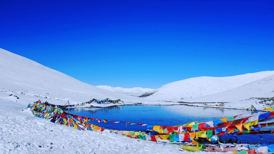 Little lake on the summit Mountain Nature Clear Sky Beauty In Nature Blue Outdoors Snow Landscape Sky Multi Colored Lake Winter Tranquility