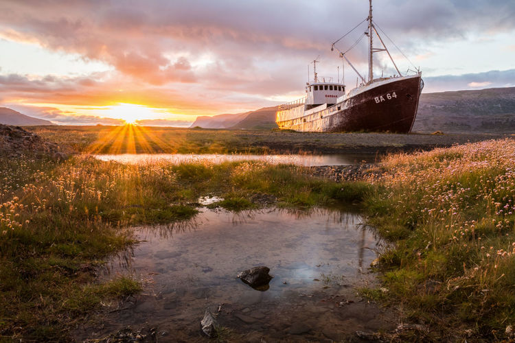 This wreck has seen many of those incredible sunsets in the past 40 years... I am thankful that I could witness at least one of them :) Beauty Beauty In Nature Boat Cloud - Sky Day Grass Iceland Landscape Landscape_Collection Nature Nautical Vessel No People Outdoors Scenics Ship Sky Summer Sunrays Sunset Sunset_collection Tranquility Travel Water Wreck
