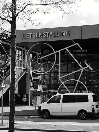 Text Architecture Built Structure Day No People Outdoors Building Exterior Sky Tree Made By Noesie HuaweiP9 Plus Photography Bycicle Parking Bycicle Art Car Art Is Everywhere The Week On EyeEm The Still Life Photographer - 2018 EyeEm Awards