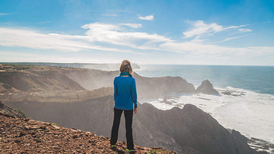 Blue Cliff Cloud - Sky Day Full Length Hiking Human Back Individuality Landscape Long Sleeved Mountain Nature One Person Only Women Outdoors Panoramic Rear View Scenics Sea View Sky Standing Tourism