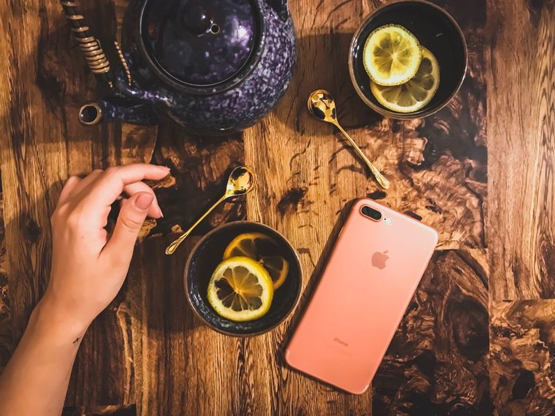 Person Holding Food And Drink Drink Indoors  Refreshment Plate Glass Beverage Man Made Object IPhone 7 Plus Tea Relaxation High Angle View