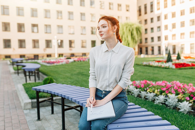 Woman Holding Book In Campus