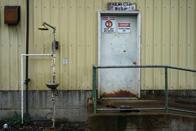 Eye Flush Chemical Chemical Hazard Hazard Pesticide Farming Corrugated Warning Sign Abandoned Abandoned Places Architecture Deterioration Damaged Rusty Weathered