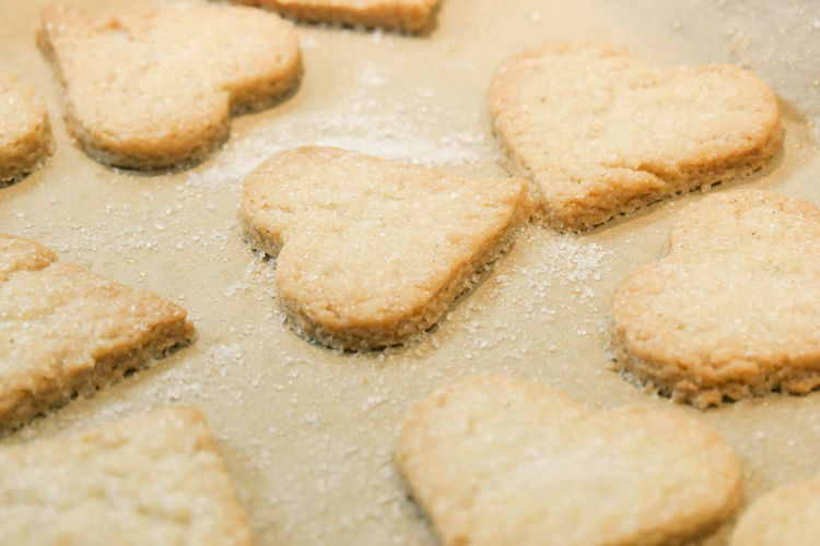 Close-up of heart shaped biscuits on wax paper