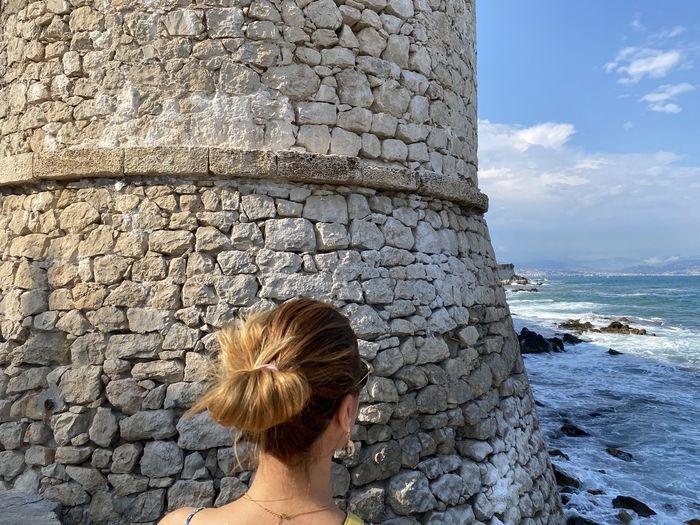 Portrait of woman against sea against sky