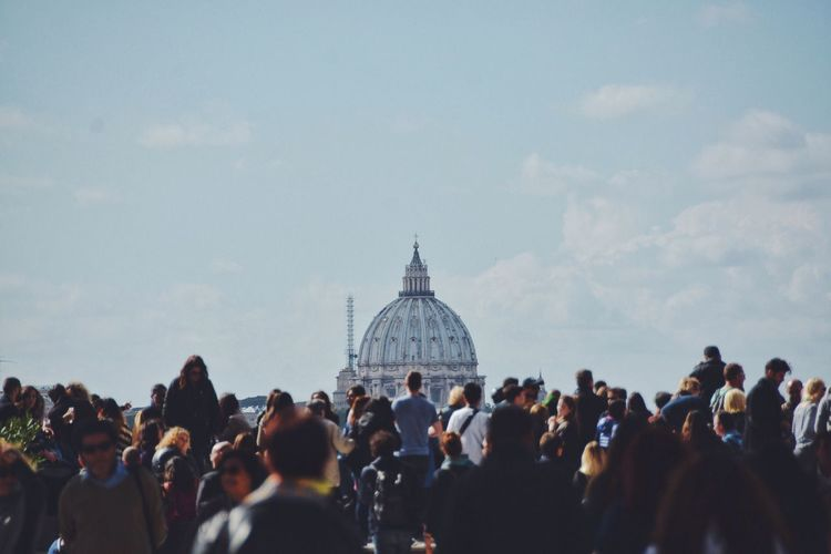 Tourist at st peters basilica against sky
